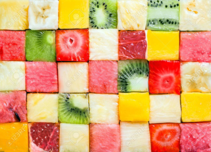 Pattern and texture of colourful fresh diced tropical fruit