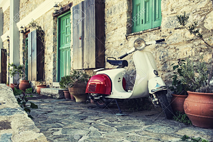 Old scooter parked by the wall